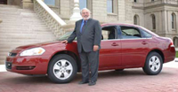 Senator Kahn and his ethanol-powered car